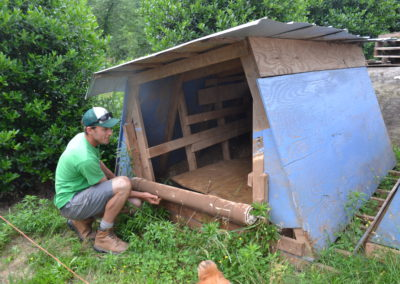 William showing the farrowing hut design.